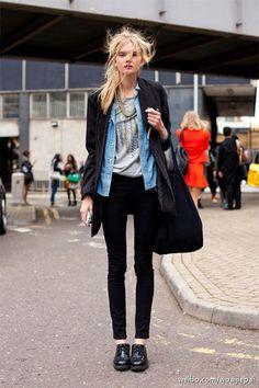 long black coat, denim button-up shirt, embellished grey t-shirt, black skinny jeans