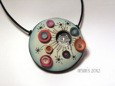 A fun garden pendant by Nikolina Otrzan on The Daily Polymer Arts blog. Nikolina has such a unique, fun and quirky style. See more at www.thepolymerarts.com