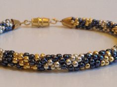 This is a tutorial how to create beautiful beaded bracelet in kumihimo technique.