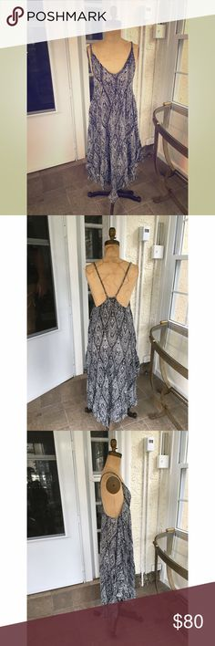 EUC Free People Dress Gorgeous, long flowy dress with black and white pattern from Free People.  Subtle high/low hem is pointed in the front and back and cut higher on the sides. Exaggerated racer back with low cut arms pairs well with a scrappy back bra. Like new condition. Free People Dresses Maxi