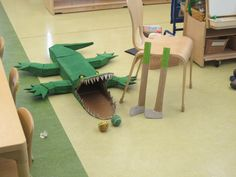 """Alligator made out of cardboard and hot glue used for a game where the children tossed a ball to """"feed the alligator"""" then made gold clubs out of a wrapping paper roll extra cardboard  hot glue and tape for the handle and the kids loved it!"""