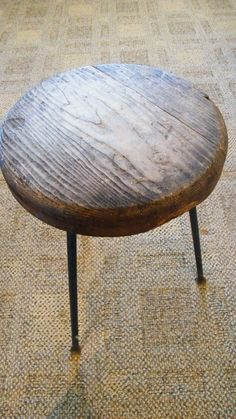 upcycled wood stool; refinished stool seat & industrial pipe legs to create an end table.