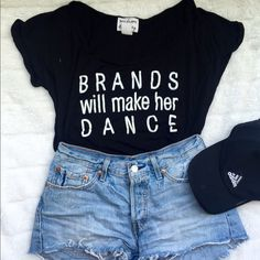 "Graphic tee Black tee with white letters ""brands will make her dance"" slightly boxy fit, wide neck, rolled/stitched sleeves. Labeled as a size large but definitely more like a small or medium. Worn only once or twice. Tops Tees - Short Sleeve"