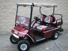 "Roll Tide Roll! Check out this beautiful ""Alabama"" color schemed electric golf cart for sale. Show off your school spirit tailgating with this 36 volt Ezgo Txt cart. Equipped with a front windshield with a very nice see thru murial. As well as a weather enclosure and some really sharp graphics per our own Bob Hoffman!"