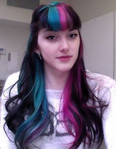 Teal blue and purple streaked hair with bangs