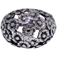 This is a lovely, unique sterling silver dome ring that is made with a floral design. Flowers are well detailed and the metal is cut out around some of them. Stamped 'sterling' inside the band. Light patina. You'll love wearing this one. Size: 7.50, weighs 6.472 grams.pShips first class mail within the USA, first class airmail worldwide. Insurance included to most countries. pActual item for sale is shown. Descriptions are as thorough as possible. pQuick shipping, satisfaction guaranteed. Vintage Silver Jewelry, Airmail, Unique Rings, Vintage Floral, Countries, Decorative Bowls, Floral Design, Vintage Fashion, Gems