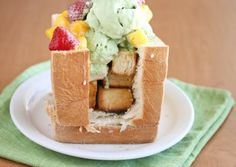 Brick toast topped with matcha green tea ice cream, mangoes, strawberries & drizzle of condensed milk Brick Toast, Green Tea Ice Cream, San Diego Food, Kitchen Reviews, Fresh Fruit, Fruit Ice, Weird Food, Bite Size, Cravings