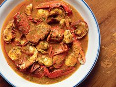 RECIPE: Lobster Hotpot  - This Menorcan specialty can be found all over the Balearic Islands. The spiny lobster, queen of the local seas, was once considered poor food (like in Maine), which only the fishermen would eat. Starts w/ a 'sofrito' of fried onion, pepper & tomatoes & ends w/ a paste of almonds, garlic & parsley to thicken the sauce. Serve w/ country bread or baguette to dunk, spoons, skewers (so people can extract the meat from the claws & legs) & finger bowls w/ water.