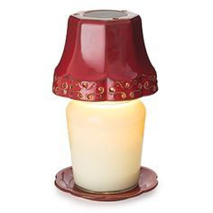 Turn your favorite Bellaroma candle into a lamp with the patented Shade Candle Warmer Lamp. Set your favorite scented candle on the matching plate and place the shade on top to create a fragrant and glowing accent to any room. Like our other lamps and lanterns a halogen light inside the shade melts the top of the candle safely releasing the candle's fragrance. Price: $35.95
