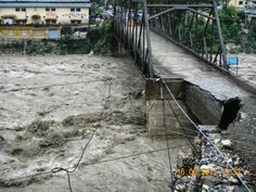 Damaged bridge over flooded river, Uttarakhand, India Posted by floodlist.com