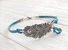 Teal Mystical Peacock Jewelry Bracelet, Silver Feather, Gift for Her, Fashion, Holiday Gift. $27.00, via Etsy.