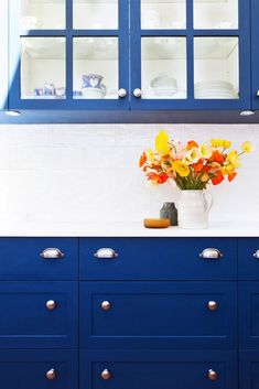 7 Clever Hacks for Faking Custom Cabinetry // Blue kitchen cabinets