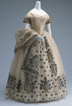 Evening Dress  1850 This elegant dress is made of mull with applications of jewel beetle elytra. 1,942 of these glistering forewings, with ...