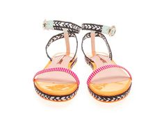 SOPHIA WEBSTER BEA SANDALS  Flat sandals last barely a season on the punishing sidewalks of Manhattan. This year I'm eschewing basic brown for black and white raffia with pops of pink and mint. — Jillian King, assistant managing editor