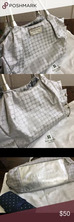 Kate Spade diaper bag and changing pad Kate Spade diaper bag with matching changing pad and dustbag.  One small stain on bottom of bag as shown, otherwise in great condition.  Handles are leather, no scratches. kate spade Bags Baby Bags