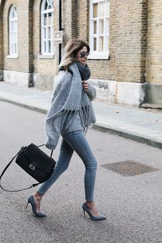 Emma Hill wears an all grey outfit, suded bag, grey skinny jeans, grey fluffy sweater grey oversized scarf