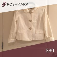 Ann Taylor jacket Beautiful winter white short jacket from Ann Taylor. 3 large button front closure and collar. 2 faux front pockets, and satin interior lining. Very classy jacket, can be worn over a nice dress for a night out or is equally stunning dressed down with skinny jeans and a black tee! Ann Taylor Jackets & Coats Blazers