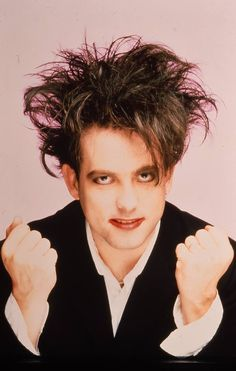 """Robert Smith used to tell his record company he had a fear of flying - purely so he could cut down on his touring commitments. """"For about three years, 1989 to 1992, I kept the pretence that I had this phobia,"""" recalls The Cure frontman. """"We did two American tours sailing over on the QE2, which was very civilized."""" Pic: Rex Features Robert Smith 1987 (from fb, 100% THE CURE)"""