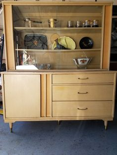 Mid Century 1950's era china cabinet finished in pickled oak. Available on Phoenix Craigslist.