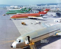 Braniff International Boeing 727-227/Adv N420BN in Orange over Ochre, with sister ships N419BN and N421BN (both in Green over Olive Green) among others on the pre-delivery line at Boeing's Renton plant, August 1973. (Photo: Boeing Aircraft)