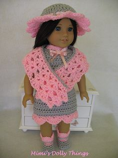 Crocheted doll clothes for 18 inch dolls including American girl. Pink and grey dress with hat, shoes and shawl.