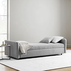 No guest room? No problem. With our Clara Sleeper Sofa, you don't have to sacrifice space, style or comfort. It's as polished as any sofa, yet it folds out easily for sleeping and hides ample storage beneath the seat. Sofa Bar, Oversized Furniture, Chair And A Half, Sleeper Sectional, Room Planning, 2 Seater Sofa, Reclining Sofa, Sofa Furniture, West Elm