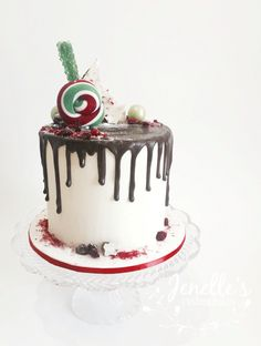 Christmas drip cake. By Jenelle's Custom Cakes!