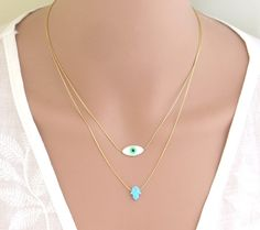 A personal favorite from my Etsy shop https://www.etsy.com/il-en/listing/462496053/double-layered-opal-hamsa-necklace-evil