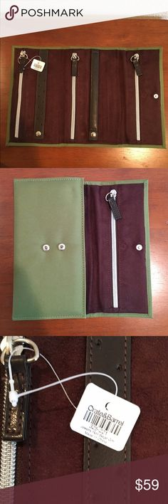 """Crate & Barrel Jewelry Roll. Vegan material. Crate & Barrel jewelry roll. Green cloth exterior,  Brown vegan sueded interior. 3 zipper compartments. 2 snap leather straps for rings and earrings. New never used, with tag. Approximately 12"""" x 8"""" when open. 2 snap option closure. Please ask questions prior to purchase. Crate & Barrel Bags Travel Bags"""