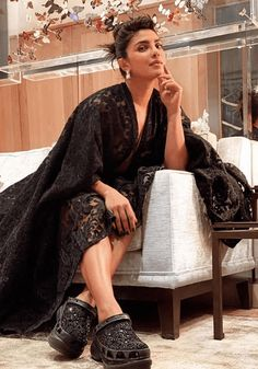 Priyanka Chopra styled her black evening dress with customised Crocs at the world-known footwear label with FN's 2020 Brand of the Year award .