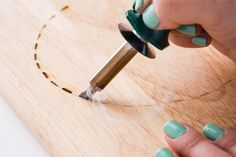 Use a wood burning kit to create a custom cheese board.