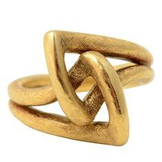 Via lifelessordinary0.tumblr.com  60's Cartier Gold Knot Ring