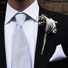 Wedding Idea for groom boutonniere purple orchid and baby's breath