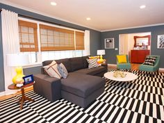 A Madeline Weinrib rug anchors this fun family room. Furniture was kept sturdy and simple enough for kids to use, while the whole look is stylish enough for adults to appreciate too, as seen on HGTV's The High Low Project. Design: Sabrina Soto