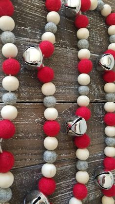 Cute silver bells, felt balls and wood beads.The perfect Christmas decor, mantel garland, shelf filler or table accent. Wood Bead Garland, Beaded Garland, Felt Ball Garland, Homemade Christmas Decorations, Holiday Crafts, Fall Crafts, Christmas Bells, Christmas Ornaments, Christmas Bead Garland