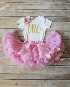 Show your little princess off in this oh so glam pink and gold first birthday outfit. This is listing includes flower headband, bodysuit and pink pettiskirt as seen in photo. Perfect for her first bir