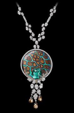 Platinum, one 9.28-carat cushion-shaped emerald, one opal, briolette-cut brown diamonds, brown diamonds, brilliants.