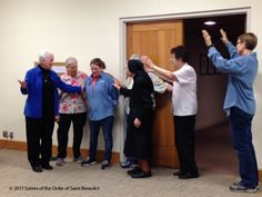 Feb 17: Sisters bless Environmental Services employee, Trinka (3rd from left), who has a new job.  Photo: Thomasette Scheeler, OSB