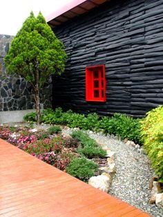 Garden at Hotel entrance in Piedras Blancas Park, Santa Elena, Antioquia - Colombia.