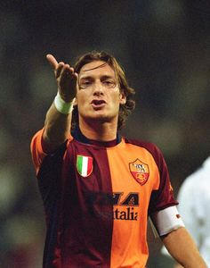 Francesco Totti of Roma makes a point during the UEFA Champions League match between Real Madrid and Roma played at the Estadio de Bernabeu in Madrid. Legends Football, Football Icon, World Football, Football Kits, Football Jerseys, As Roma, Totti Francesco, Totti Roma, Long Haired Men