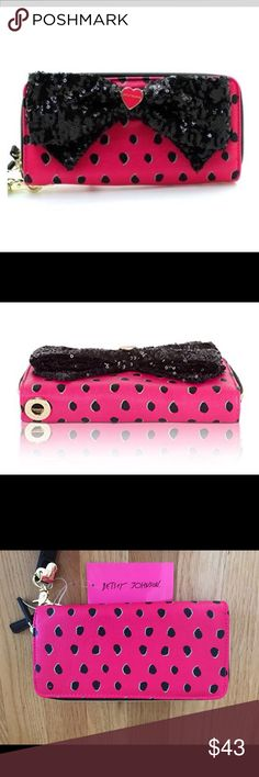 """Betsey Johnson NWT Fuchsia & Blk Double Zip Wallet New With Tags And Box Betsey Johnson Fuchsia And Black Dotted Double Zip Around Wallet With A Large Black Sequined Bow. The Black Dots Feature A Pale Blue Accent And A GoldToned Betsey Heart Emblem. Detachable Wristlet Strap. Dual Zip Around Closure. The Interior Contains Four Bill Slots, Five Card Slots, Two Slip Pockets And One Zippered Pocket. Gold Vinyl And Logo Interior Fabric. Gift Box Included. 8""""L X 4""""H X 1.5"""" D. MSRP 75.00. Betsey…"""