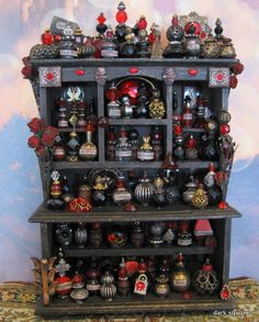 I might be able to do a simplified version of this with beads!  Dark Heart assemblage cupboard in one inch scale by Dark Squirrel.