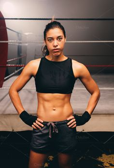 Confident relaxed female boxer with a toned body by Jacob Lund Photography on @creativemarket