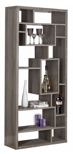 """Give your home a bold, modern look with this Sandy 72"""" dark taupe, reclaimed wood-look bookcase. This chic, backless unit features 14 asymmetrical shelves in various sizes, perfect for displaying your favorite books, frames or other decorative items. Place this bookcase against any wall in your home or in the center of the room as a room divider."""