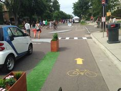 Are One-Day Plazas and Bike Lanes changing your town or city? ^AH The Minneapolis Bicycle Coalition installed this pop-up lane and intersection treatment at an Open Streets event to show neighbors what a pr. Urban Furniture, Furniture Plans, Furniture Buyers, Luxury Furniture, Urban Intervention, Traffic Light, Modern City, Future City, Arquitetura