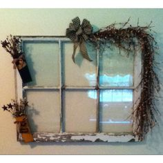 Barn window rescued from the trash; now hangs in my kitchen.