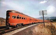 Beautiful picture of the complete Powhatan Arrow train showing the rear observation coach. Taken near Ronanoke, VA. Late 1950's?