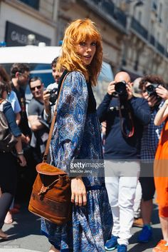 Model Julia Johansen wears a blue paisley dress and brown suede purse after the Jean Paul Gaultier couture show on July 06, 2016 in Paris, France.
