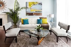 white upholstered sofa with green and yellow pillows, white bench with cushion, glass coffee table of Small Couches to Match the Small Space