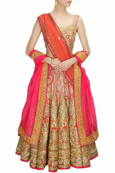 This golden and pink lehenga choli features in a couture gold silk with resham and dori embroidery and zardosi beads.This Golden and Pink Bridal Lehenga Choli comes along with a pink fully embroidered
